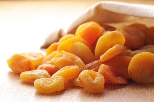 Heap-of-dried-apricots-spill-out-canvas-bag